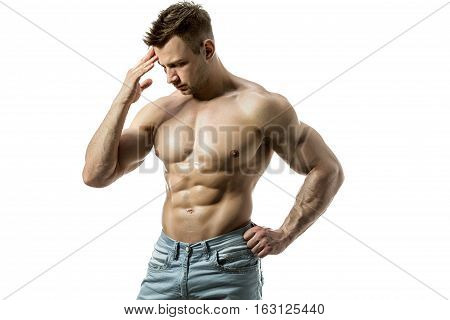 A young man with a beautiful physique thinking on a white background. Isolate