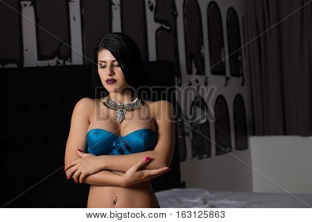 Sexy woman posing in bedroom in her lingerie