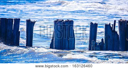 a broken pier at folly beach sc