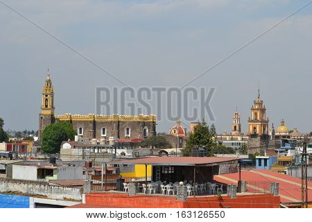 View of the city of Cholula from the top of a pyramid. The city has over 365 church so no matter where you look you will see one or more. Puebla, Mexico