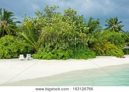 Maldivian island. Paradise in tropics beautiful beach and tropical sea