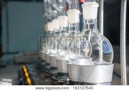 Laboratory equipment glass bottles round bottom flask on heating mantle Soxhlet Extraction