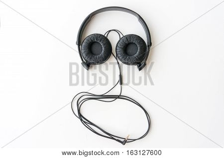 The headphone making a face on white background