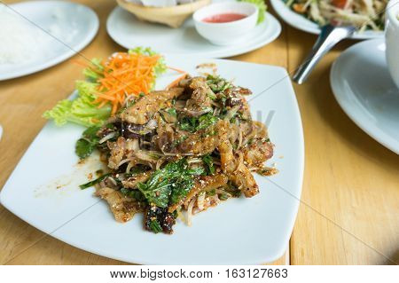 Grilled pork salad and cooked rice on the table