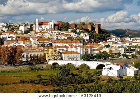 Silves, Portugal, November 29, 2016: Roman bridge, old town and the castle of Silves in Portugal.