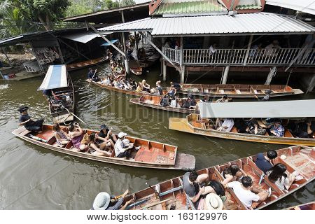 BANGKOK, THAILAND - November 5, 2016: Intense boat traffic in the canals of the floating markets in Bangkok Thailand