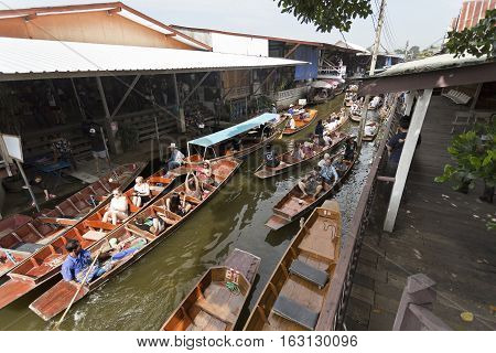 BANGKOK, THAILAND - November 5, 2016: Intense boat traffic in the canals of the floating markets in Bangkok Thailand