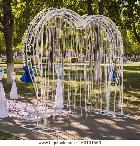 wedding arch, attribute and décor for the wedding, decoration of wedding ceremony