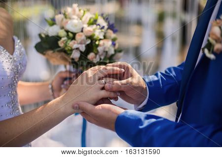 wedding rings on their hands a ring on the finger exchange rings wedding ceremony