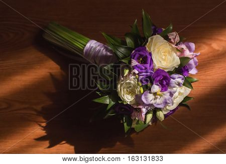 bridal bouquet of white and blue flowers