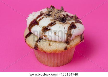 Cupcake dessert over pink background isolated dessert