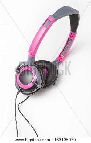 Kids pink audio headphones isolated over white background.