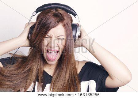 Woman With Headphones Having Fun.