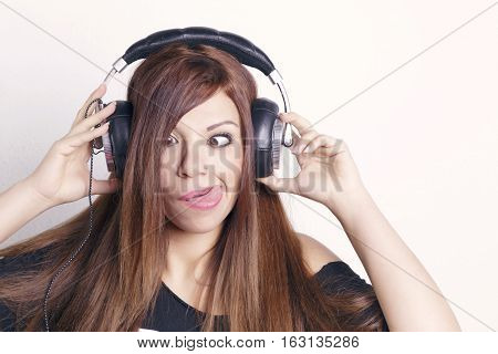 Woman With Headphones Having Fun.