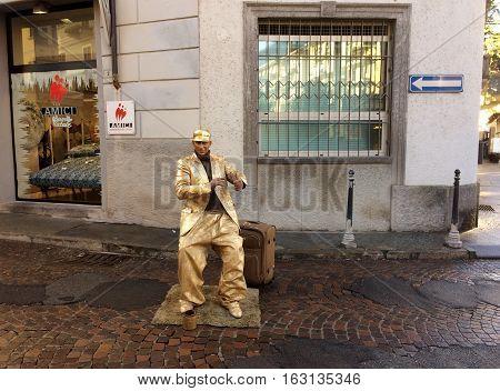Street artist on display for Christmas. 24 December 2016, Domodossola,Piemonte,Italy