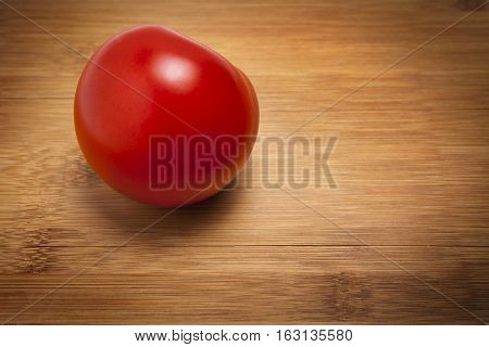 Red Ripe Tomato on Cutting Board isolated