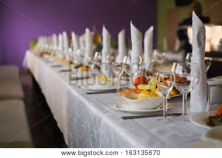 festive wedding table piled with food, party in a restaurant