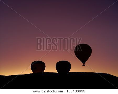 Silhouette Of Hot Air Balloons Flying Over The Cappadocia Valley