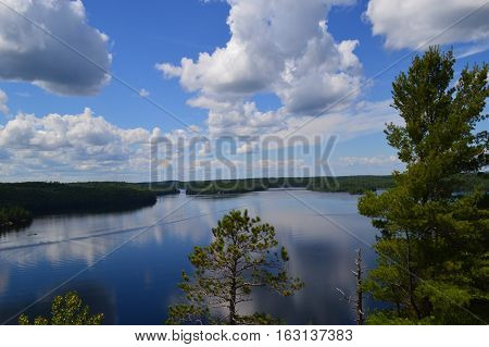 View of lake with trees and clouds