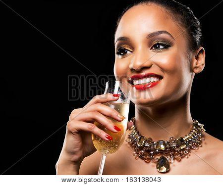 Beautiful Brunette With Dark Makeup Wearing Gold Jewellery