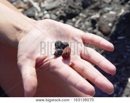 Beach Rocks In Hand  Near Exo Gialoso Beach In Santorini