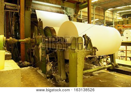 Tissue paper rolled on machine in factory line