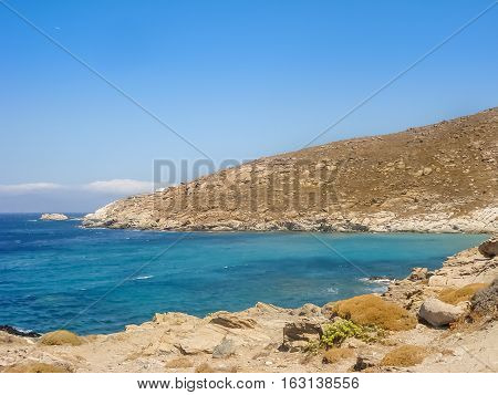 Beach In Mykonos Under  The Blue Sky