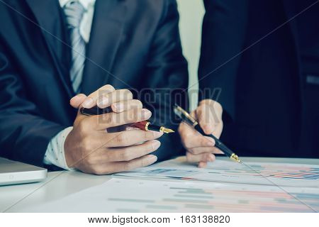 Teamwork Concept. business team work working plan the business and analysis many chart graph. Film effected photo.