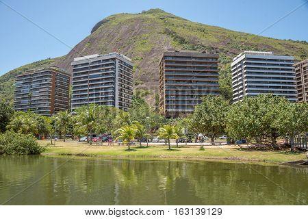Rodrigo de Freitas Lagoon and four elite residential house against the background of the hill at Lagoa district, Rio de Janeiro, Brazil