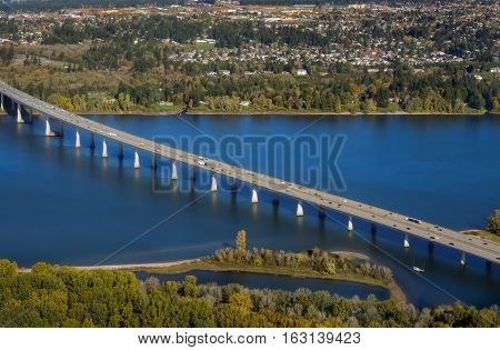 Bridge crossing Columbia River, connecting Portland, OR and Vancouver, WA.  Scenic river, city and water view.