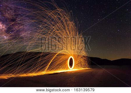 Glowing Sparks and the Milky Way on the desert floor