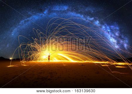 Arched Milky Way and Fiery Sparks on desert lake bed
