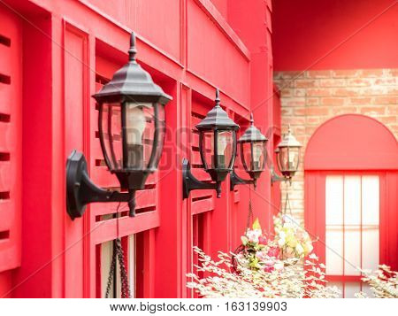 vintage style outside lamp hanging on the red wall background