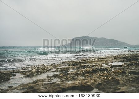 Stormy winter day at Mediterranean sea coast in Alanya, Mediterranean region, Turkey