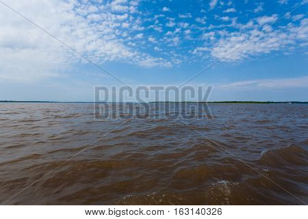 Meeting Of Waters. Brazilian Rivers Confluence From Manaus