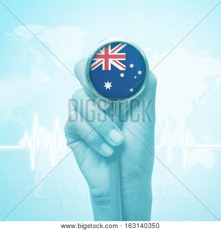 hand of doctor  holding stethoscope with Australia flag.