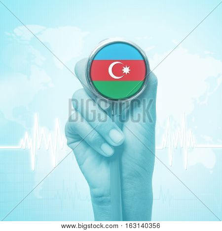 hand of doctor holding stethoscope with Azerbaijan flag.