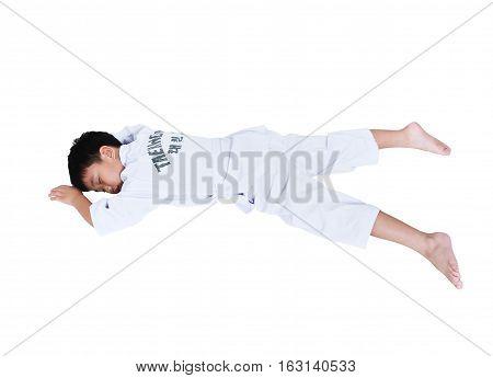Accidents In Sports. Asian Child Athletes Taekwondo Lying Prone Position Unconscious.