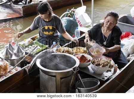 BANGKOK, THAILAND - November 5, 2016: Cooking on the boat at the floating markets of Bangkok Thailand