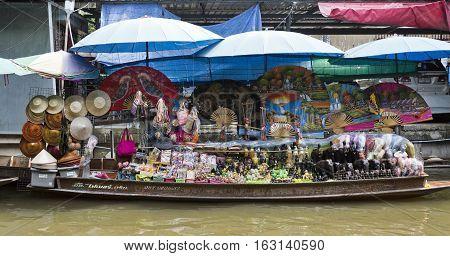 BANGKOK, THAILAND - November 5, 2016: Stall selling local souvenirs along the floating markets of Bangkok Thailand