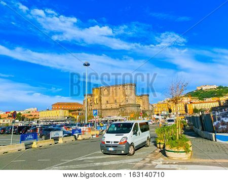 Napoly, Italy - May 04, 2014: Castel dellOvo and cars at port area at Napoly, Italy on May 04, 2014
