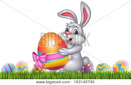 Vector illustration of Easter bunny with decorated Easter eggs in a field