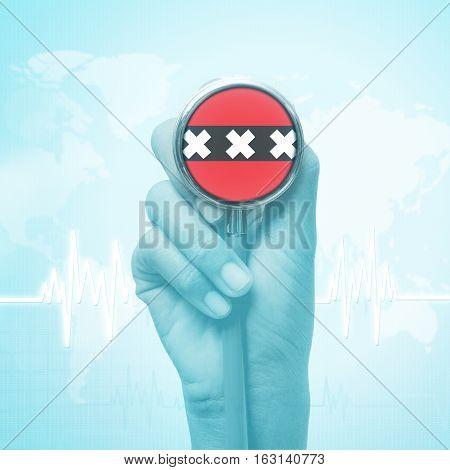 doctor hand holding stethoscope with Burundi flag.