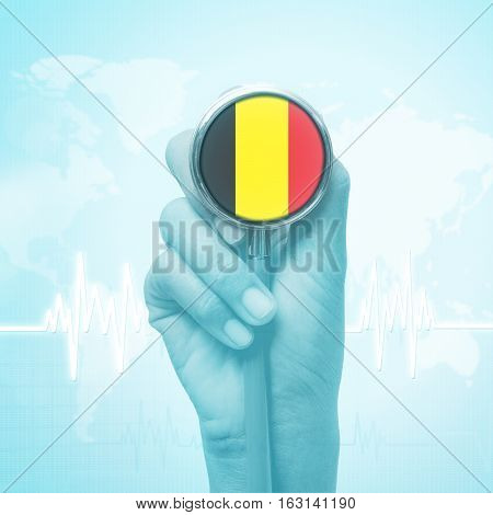 doctor hand holding stethoscope with Belgium flag.