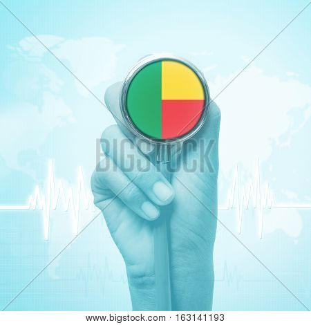doctor hand holding stethoscope with Benin flag.