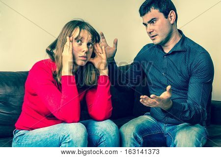 Young Couple Into An Argument In Living Room