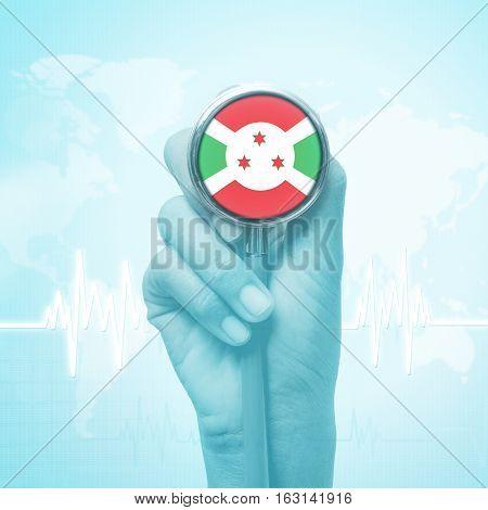 hand  of doctor holding stethoscope with Burundi flag.