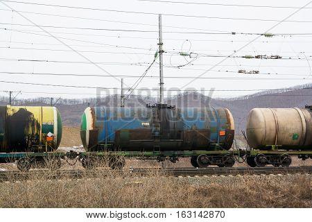 Railway Cisterns Under Electric Wires. Autumn Landscape.