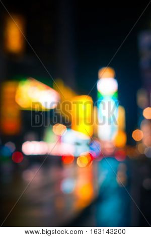 Times Square abstracted and blurred softly at night.