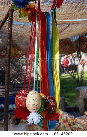 Decorative painted Easter eggs hanging on a clothesline color